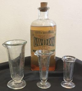 Lavodin Iodine Antiseptic patent medicine with glassware.