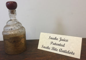 "Snake-shaped bottle containing a patented ""snake bite antidote."""