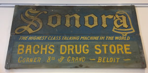 Advertising sign for Bach's Drug Store featuring Sonora Phonographs.