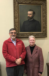 AIHP Executive Greg Higby and Jeanette Roberts, the former Dean of the UW-Madison School of Pharmacy, pose with a portrait of Edward Kremers, the second Director of the UW School of Pharmacy.
