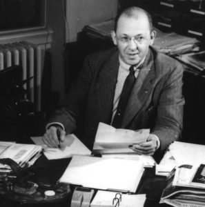 Robert P. Fischelis, Executive Secretary of the APhA, at his desk in the late 1940s.