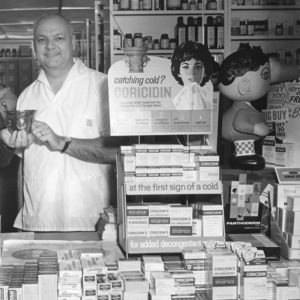 Richard Bogard behind the counter of his pharmacy.