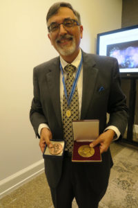 Greg Higby shows the Parmentier Medal (left) and the Urdang Medal he received on Friday at the International Academy Meeting.